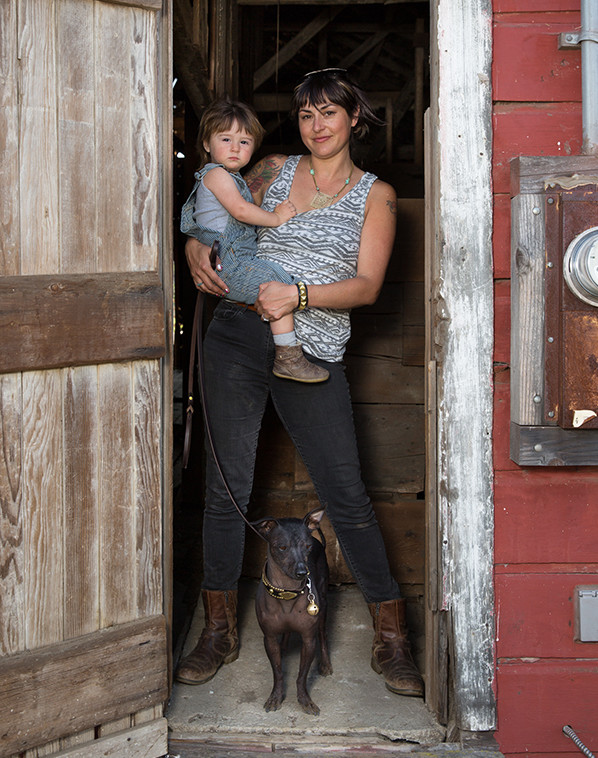 Ana Poe, owner of Paco Collars, holding her son Levi.
